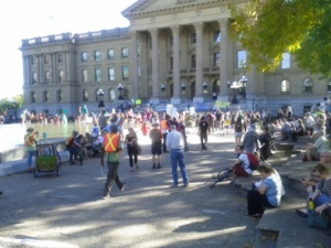 Hundreds of people gathered in the Alberta Legislature Grounds