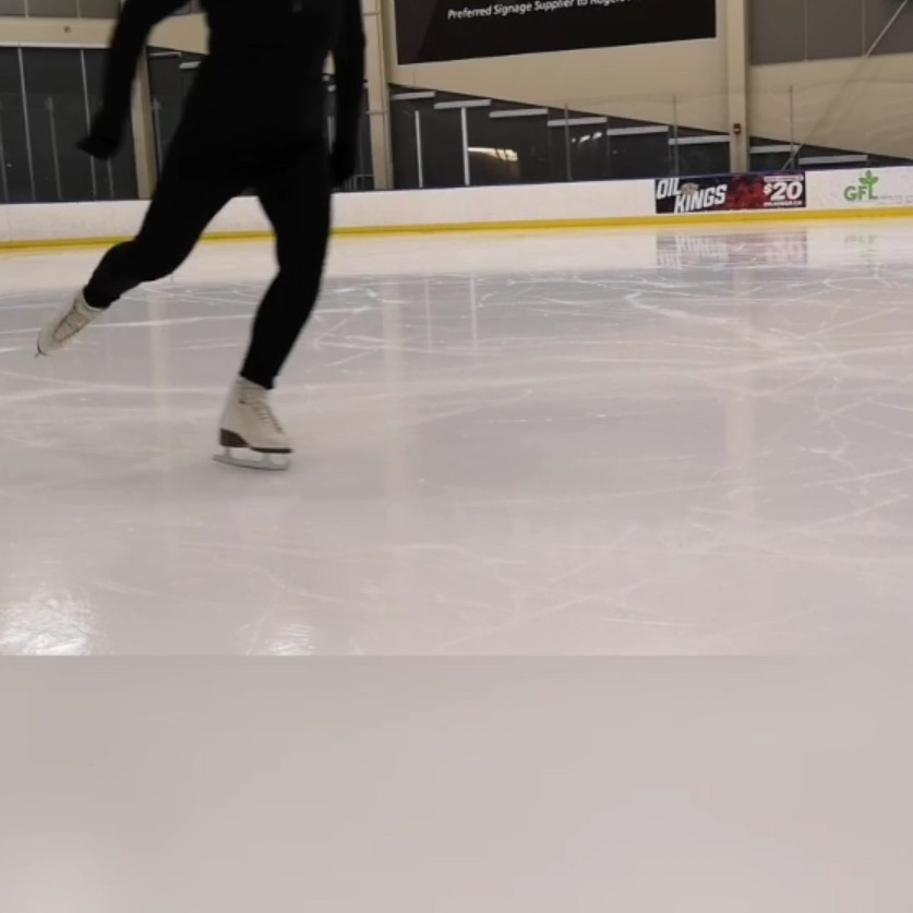 Figure skater on one leg about to jump